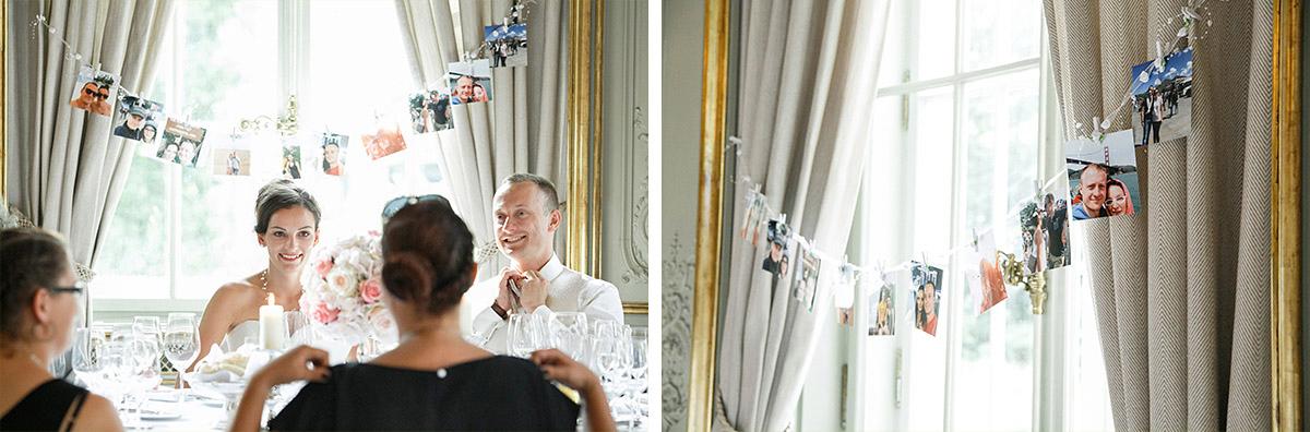 Hochzeitsfoto von Brautpaar bei Hochzeitsfeier und Detailfoto von Fotogirlande als Hochzeitsdekoration aufgenommen von Hochzeitsfotograf im Schlosshotel Grunewald © Hochzeit Berlin www.hochzeitslicht.de