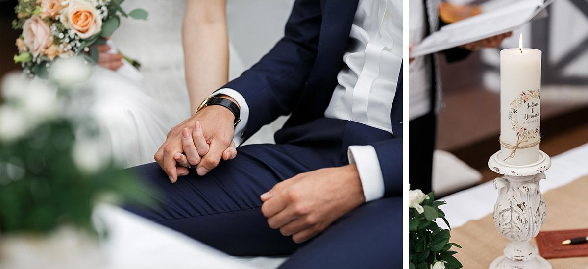 Hochzeitsreportagefotos bei Trauungszeremonie von händehaltendem Brautpaar und Traukerze - Seelodge Kremmen Hochzeitsfotograf © www.hochzeitslicht.de