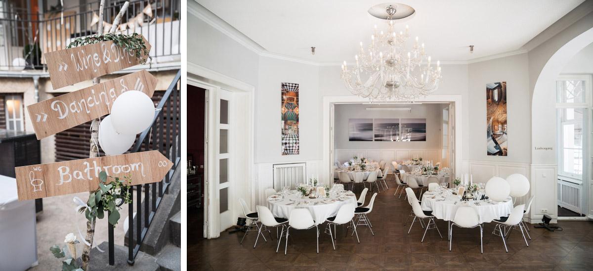 geschmückter Festsaal und Holzschilder bei DIY Hochzeit - Villa Blumenfisch Hochzeitsfotograf © www.hochzeitslicht.de